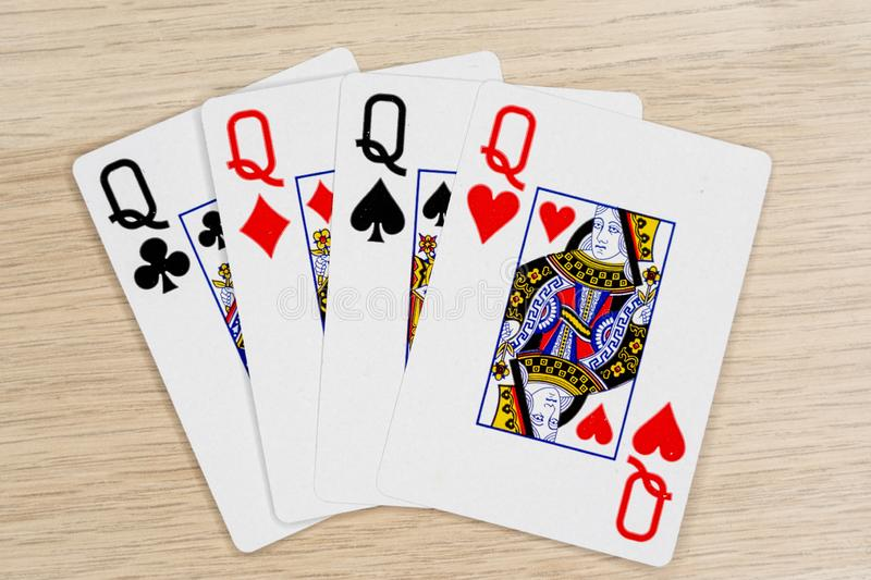 4 of a kind queens - casino playing poker cards royalty free stock photos