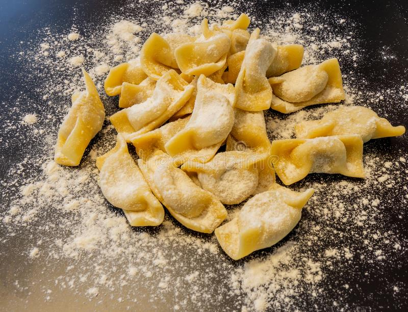 A kind of ravioli, casoncelli, home made traditional food of the Bergamo area, Italy. Delicious Italian food royalty free stock photos
