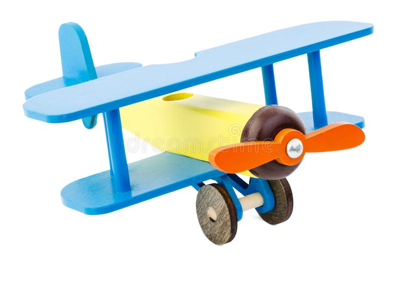 Kind-` s Fläche der gelben blauen Farbe gemacht vom Holz lokalisiert auf weißem Hintergrund stockbild