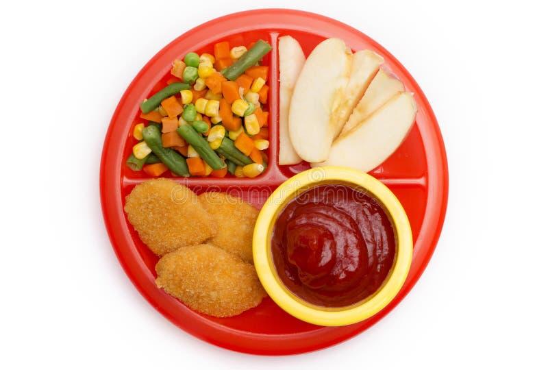 Kind-` s Mahlzeit von Hühnernuggets, von Früchten und von Veg lizenzfreie stockfotografie