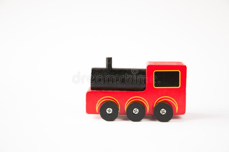Kind-` s Spielzeug Roter hölzerner Zug lizenzfreie stockbilder