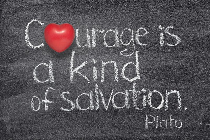 Kind of salvation heart. Courage is a kind of salvation quote of ancient Greek philosopher Plato written on chalkboard with red heart symbol instead of O stock photography