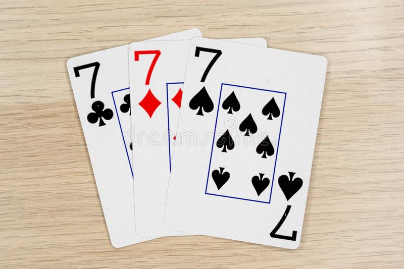 3 of a kind sevens 7 - casino playing poker cards stock photography