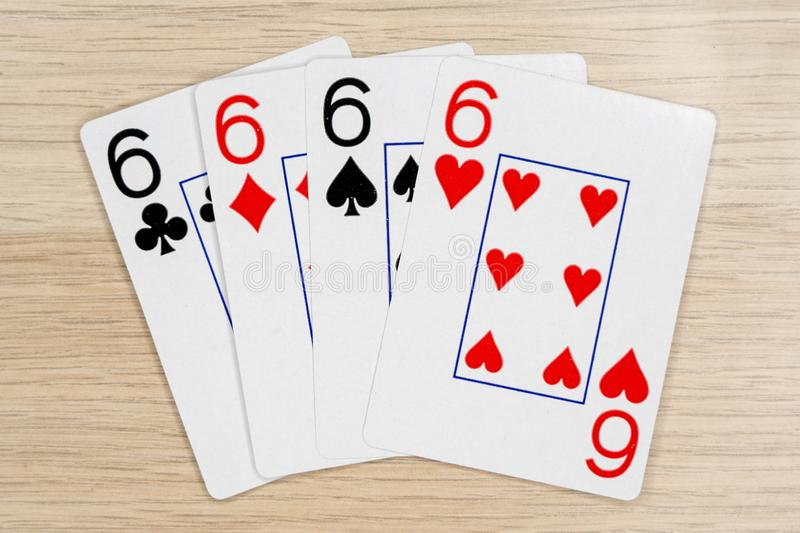 4 of a kind sixes 6 - casino playing poker cards stock images
