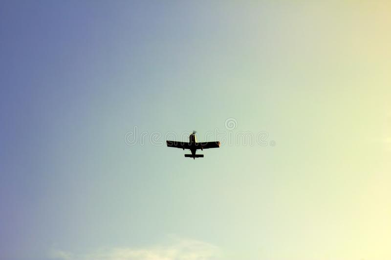 Kind of sports aircraft single with massive wings in air stock images