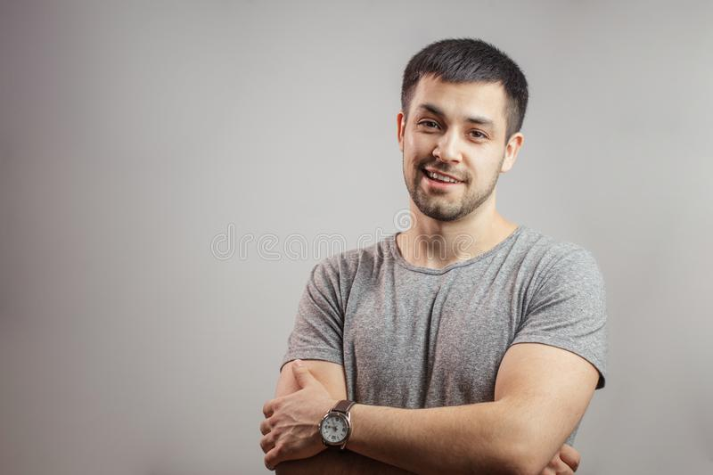Kind sportsman with folded arms. Kind sportsman is standing with folded arms. personal fitness trainer. copy space.brutality concept. friendly weightlifter royalty free stock photo