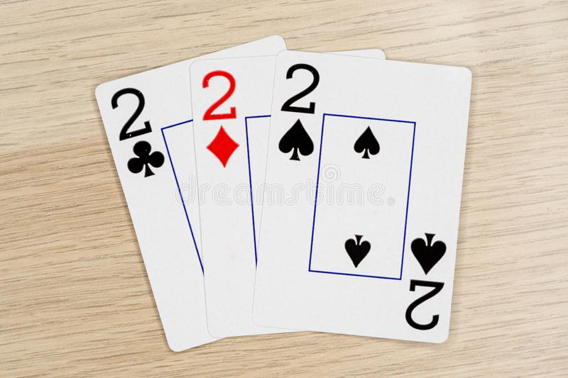 3 of a kind twos 2 - casino playing poker cards royalty free stock images