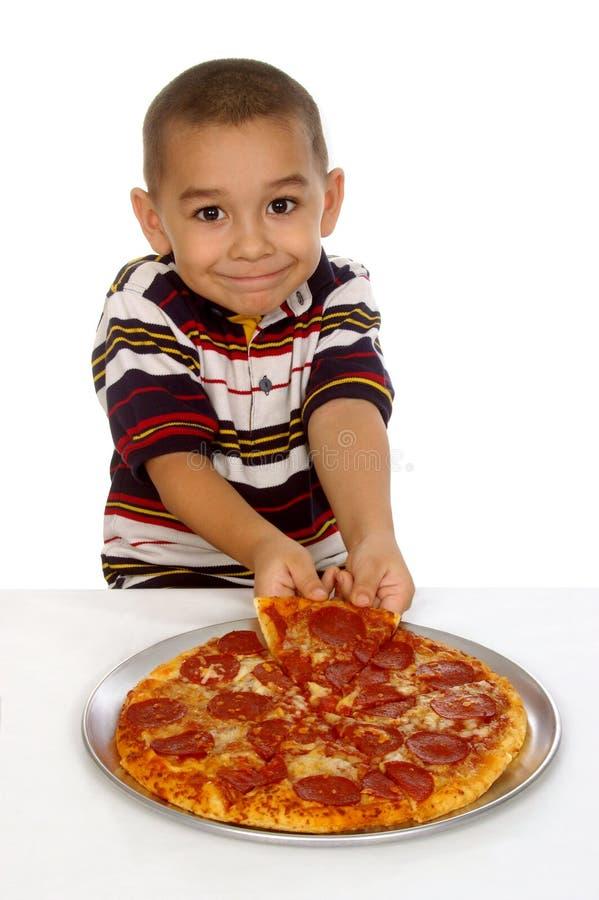 Kind und Pizza lizenzfreie stockfotografie