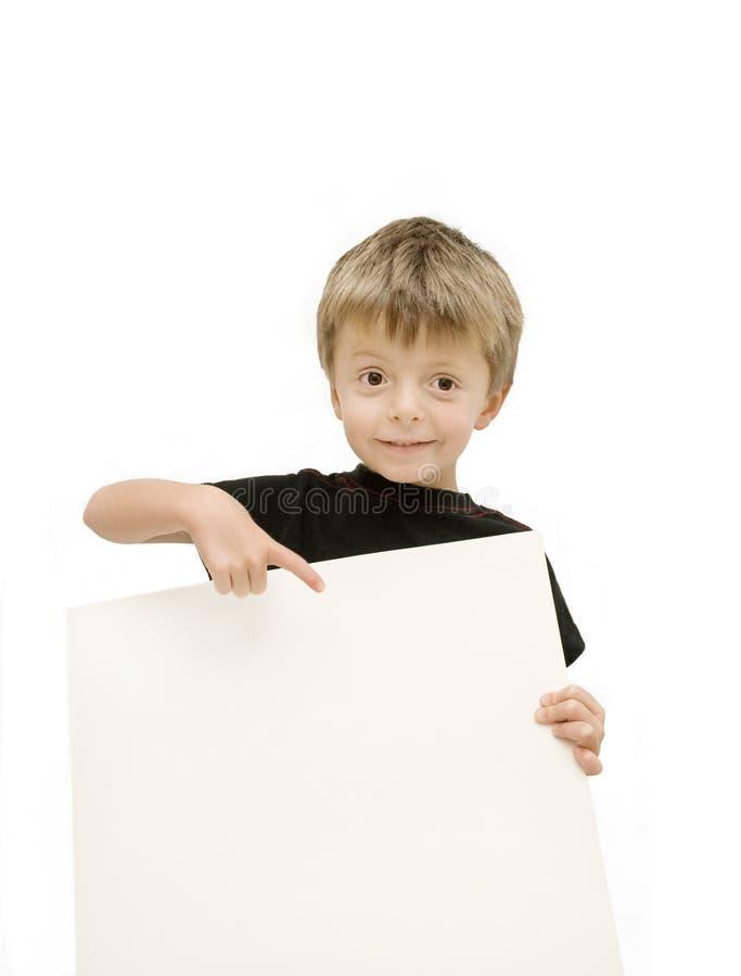 Kind und unbelegtes Zeichen stockfotos