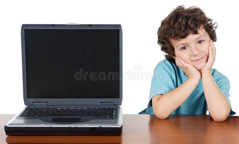 Kind Whitlaptop lizenzfreie stockbilder