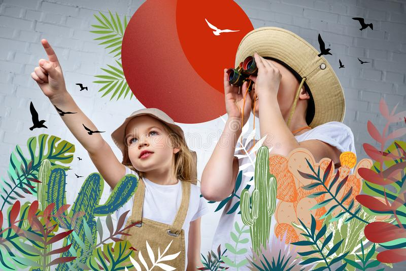 Kinder in den Safarikostümen und -hüten zeigend und in den Ferngläsern Vögeln betrachtend stock abbildung