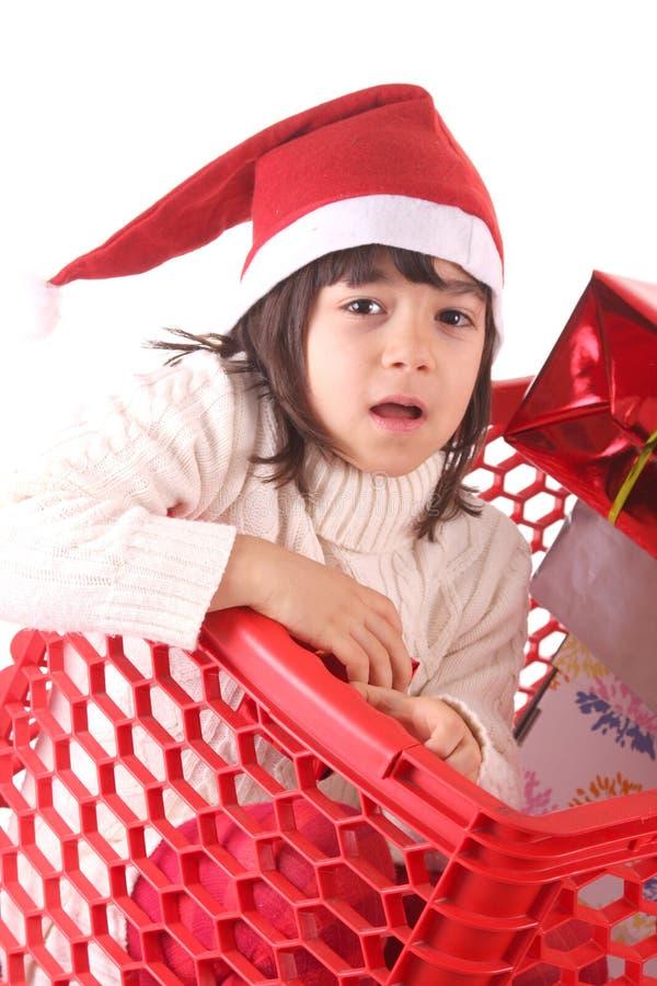 Kinder in einem Einkaufswagen stockbild