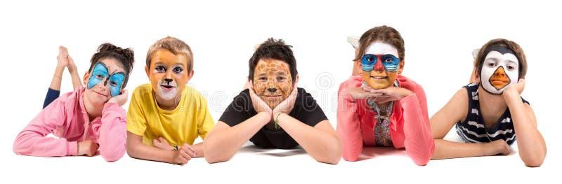 Kinder mit Tiergesichtfarbe lizenzfreie stockfotografie