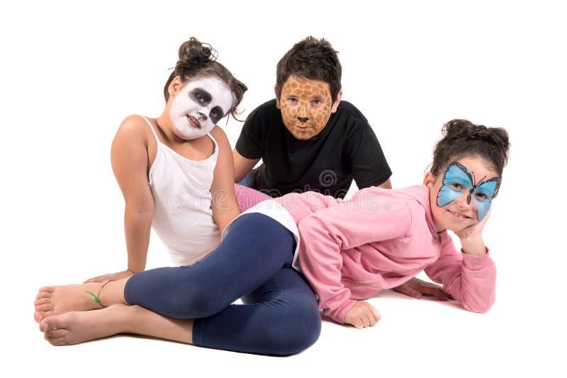 Kinder mit Tiergesichtfarbe lizenzfreie stockfotos