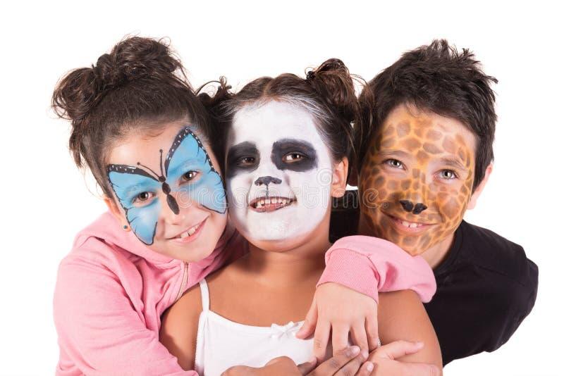 Kinder mit Tiergesichtfarbe stockfoto