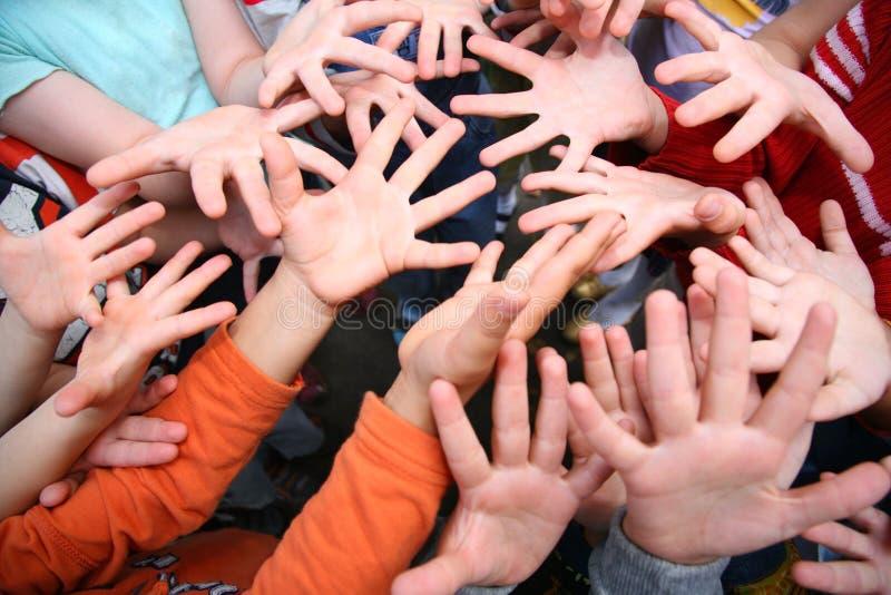 Kinder `s Hände stockbild