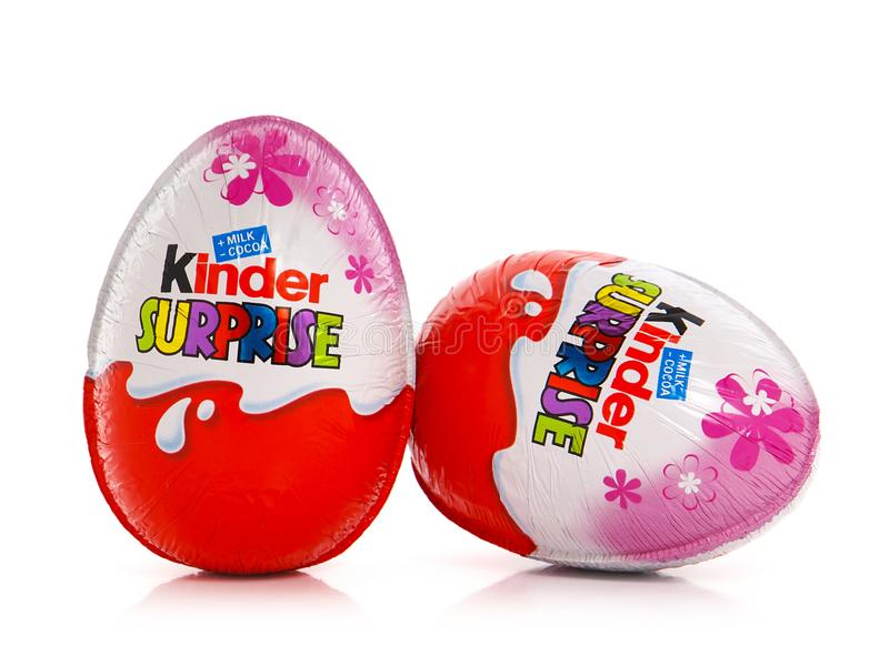 Kinder Surprise for girl, chocolate eggs containing a small doll royalty free stock image