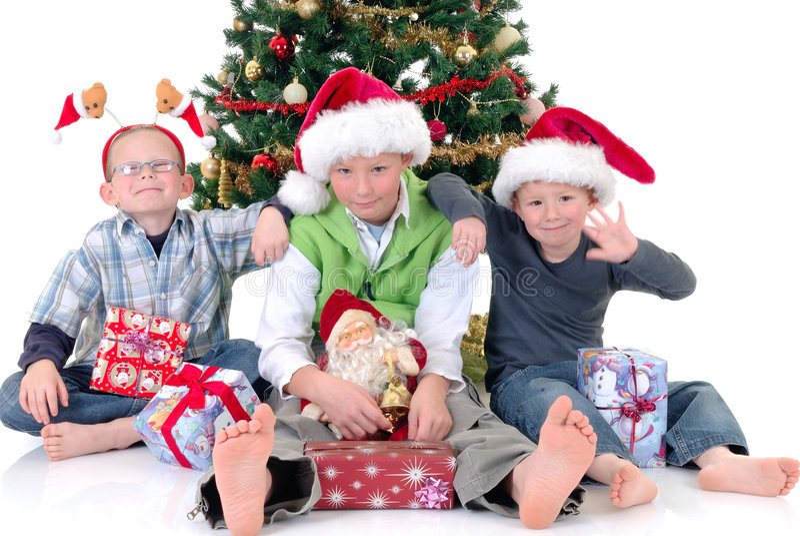 Kinder um Weihnachten drei stockfotos