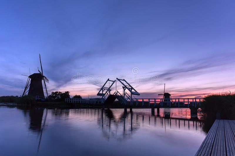 Kinderdijk windmills in the netherlands on sunset royalty free stock images