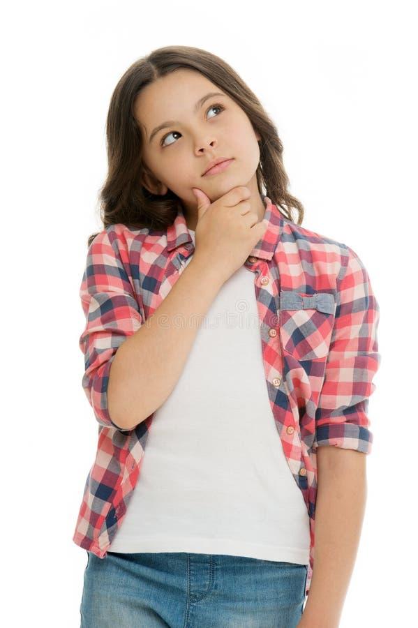 Kinderdurchdachtes Gesicht machen Entscheidung lokalisiertes Weiß Kindernettes Gesicht Brunette-Haardenken Zufälliger Blick des M stockbild