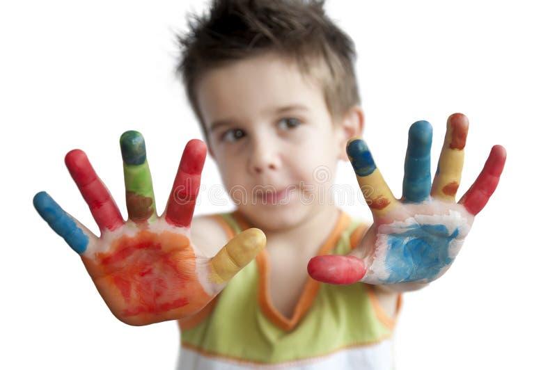 Kinderen gekleurde handen. Weinig jongen overhandigt. royalty-vrije stock foto