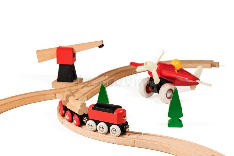Kinderen houten spoorweg en vliegtuig royalty-vrije stock afbeelding