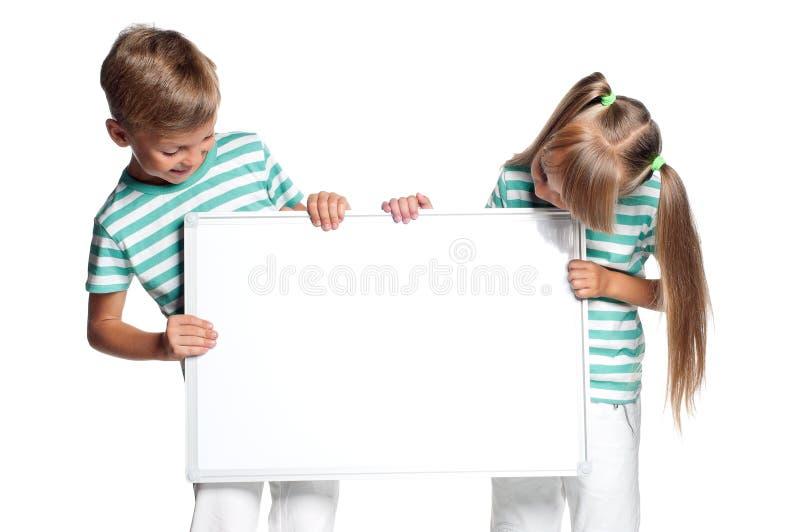 Kinderen met witte spatie royalty-vrije stock afbeeldingen