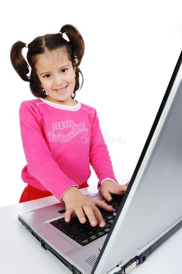 Kinderen op laptop stock foto's