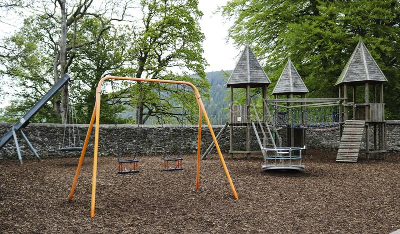 Kinderen` s Speelplaats met schommeling royalty-vrije stock afbeelding