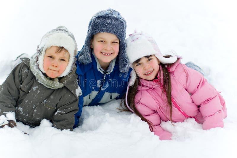 Kinderen in Sneeuw royalty-vrije stock foto's
