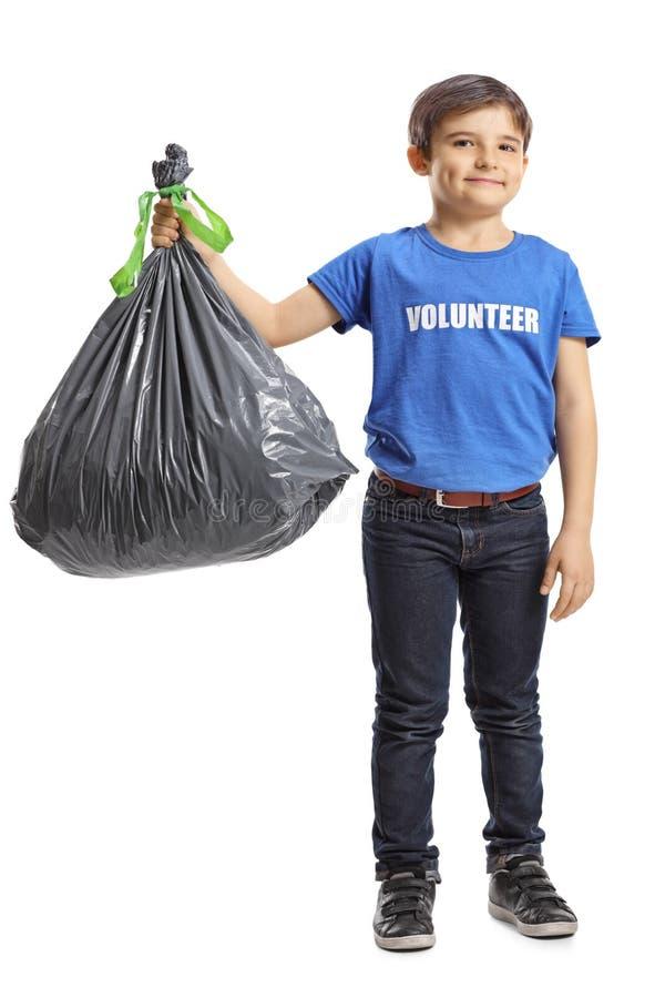 Kinderfreiwilliger, der eine überschüssige Tasche hält stockbild