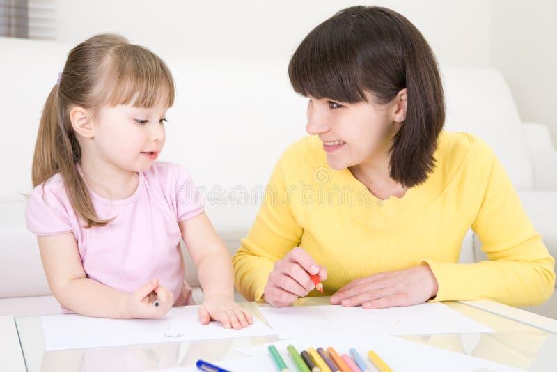 Kindergarden. Mother and daughter having fun in kindergarden stock photos