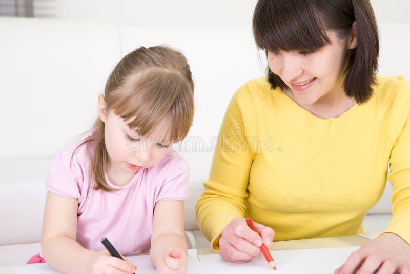 Kindergarden. Mother and daughter having fun in kindergarden royalty free stock images
