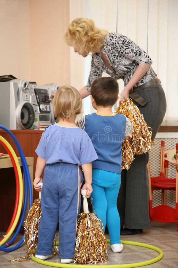 In kindergarten. Girl and boy in kindergarten royalty free stock image