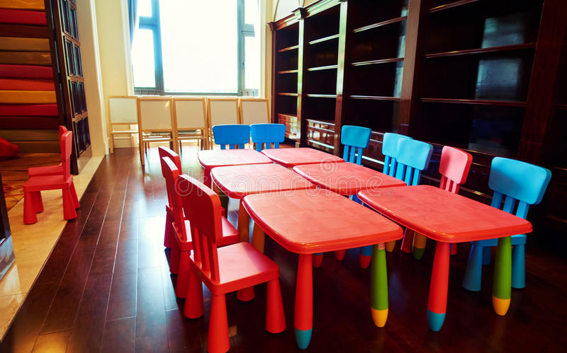 Kindergarten classroom. Or preschool classroom with small kids tables and chairs stock photography