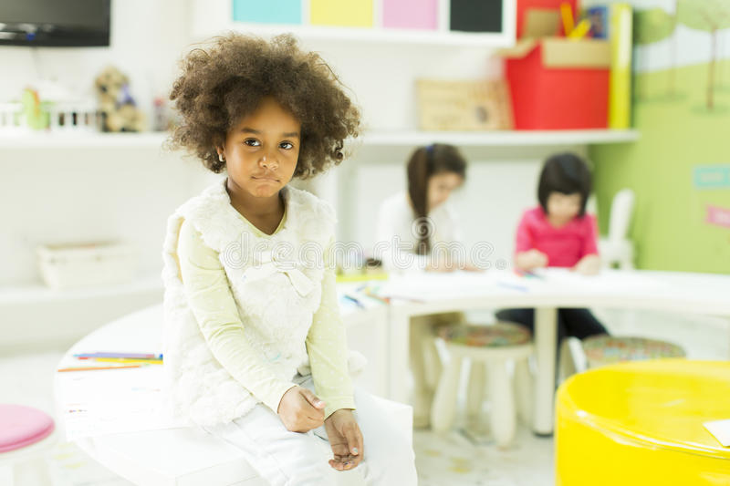 Kindergarten. Face expression and gesticulation of a little girl in the kindergarten royalty free stock photo