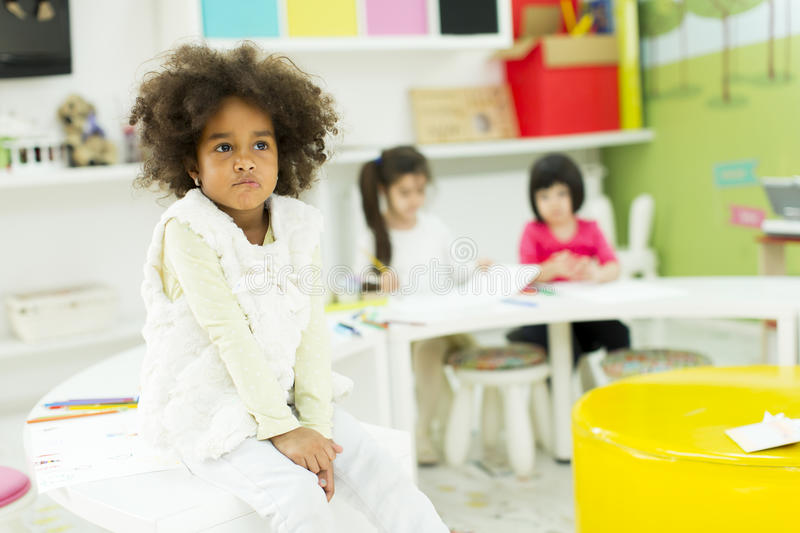Kindergarten. Face expression and gesticulation of a little girl in the kindergarten stock images
