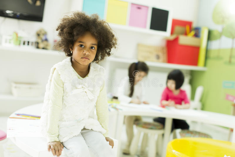 Kindergarten. Face expression and gesticulation of a little girl in the kindergarten royalty free stock photography