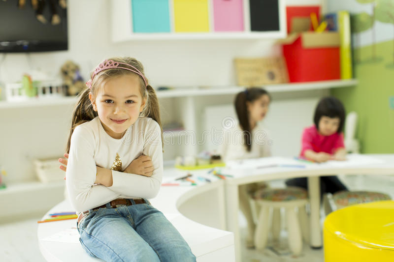 Kindergarten. Face expression and gesticulation of a little girl in the kindergarten stock photography