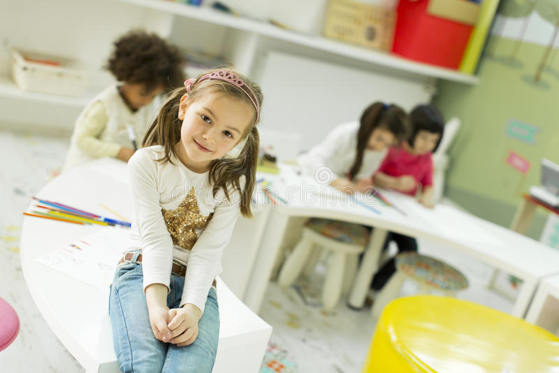 Kindergarten. Face expression and gesticulation of a little girl in the kindergarten royalty free stock images