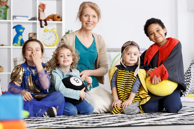 Kindergarten group in costumes stock photography