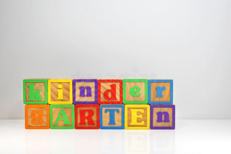Kindergarten spelled out with ABC blocks royalty free stock images