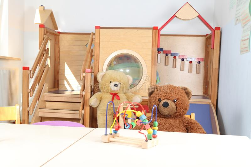 Kindergarten without staff only toys and teddy bears. A room in a Kindergarten without staff only toys and teddy bears royalty free stock photo