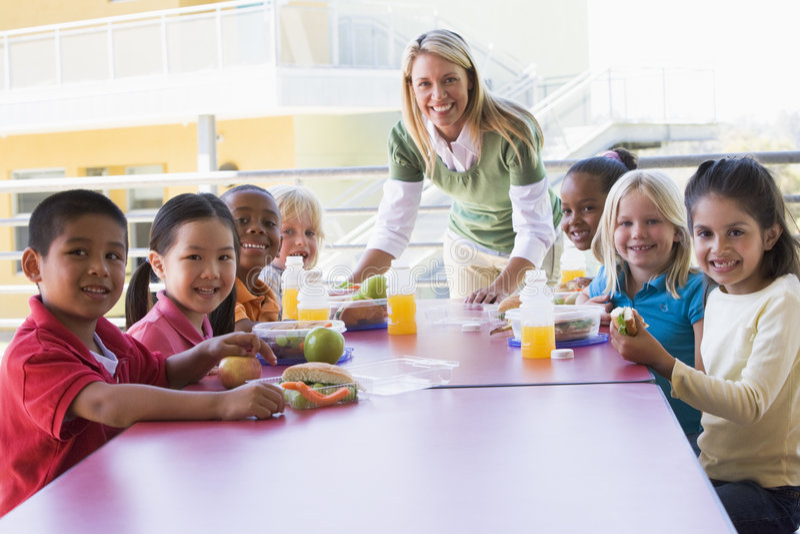 Kindergarten teacher supervising children stock photo