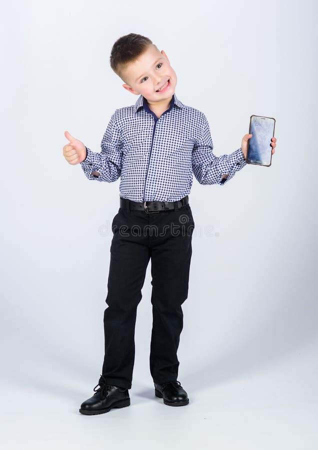 Kinderjaren Bedrijfs mededeling Kleine werkgever r E het zekere kind heeft zaken stock foto