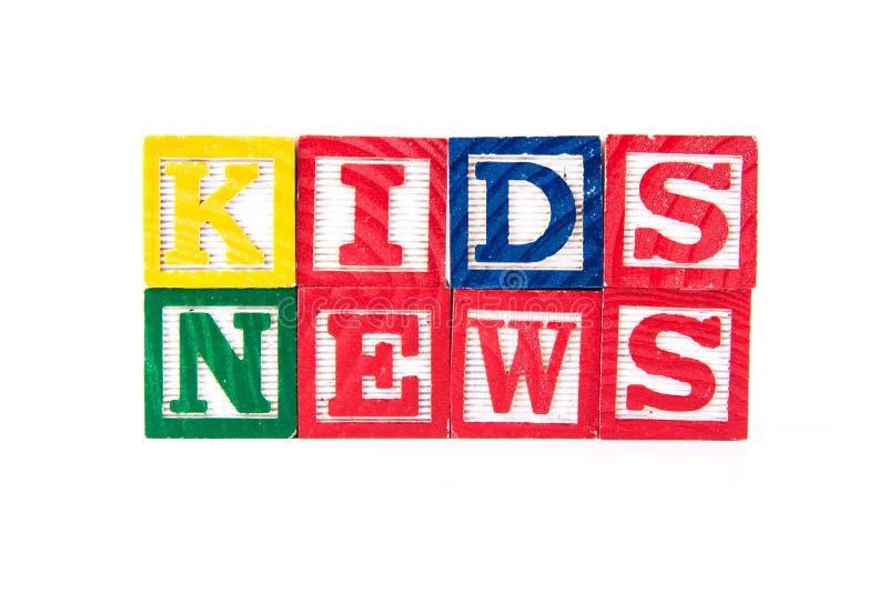 Kindernachrichten - Alphabet-Baby-Blöcke auf Weiß lizenzfreie stockfotografie