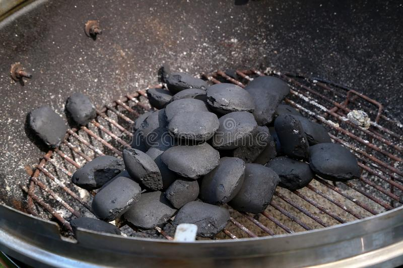 Kindling of fire for cooking on a grill stock photography