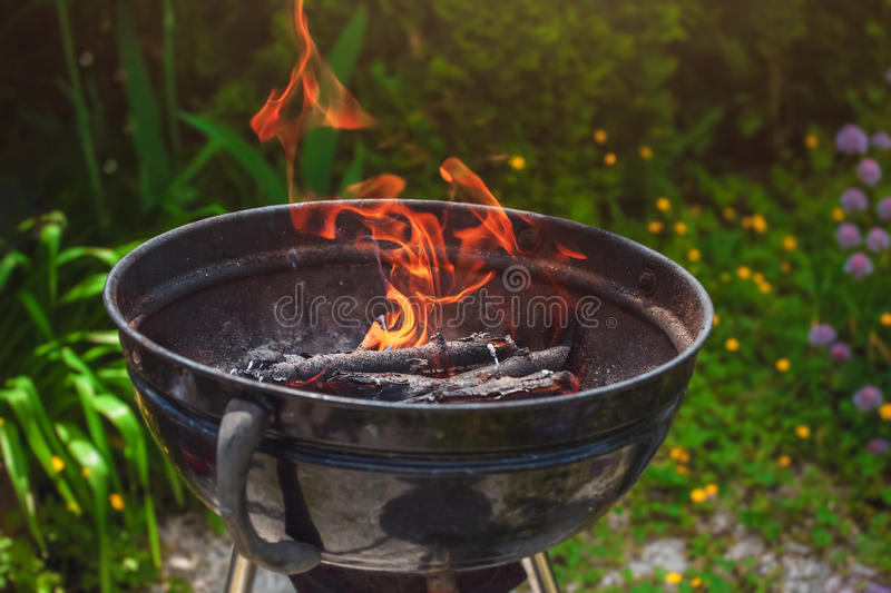 Kindling wood in the grill for a barbecue outdoors. stock images