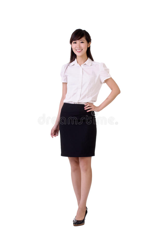 Kindly business woman. Of Asian, full length portrait isolated over white stock photos