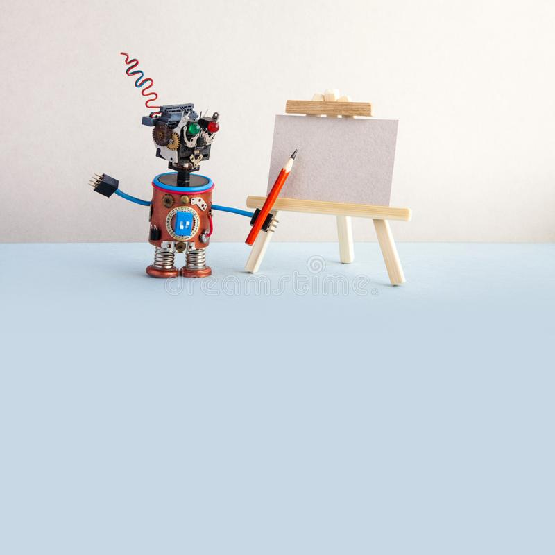 Kindly robot artist begins to create a drawing with a pencil. White paper template, wooden easel. Advertising poster. Studio school of visual arts. Blue royalty free stock photography